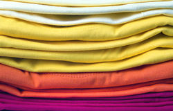 Pile of bright folded clothes Royalty Free Stock Photo
