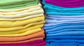 Pile of bright folded t-shirts Royalty Free Stock Photo
