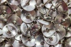 Pile of bright silver thumbtacks background Royalty Free Stock Photo