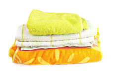 Pile of bright towels. Isolated on white background Royalty Free Stock Images