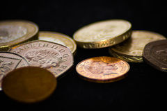 Pile of British Coins. On the dark background royalty free stock photography