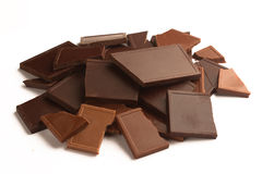 Pile of broken chocolate bars in many colors and flavors Royalty Free Stock Photos