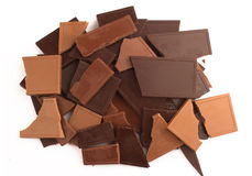 Pile of broken chocolate bars in many colors and flavors Stock Images