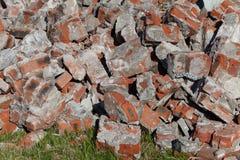 Pile of broken red bricks on construction site, garbage Stock Image