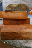 Pile of brown bricks and construction tool Royalty Free Stock Image