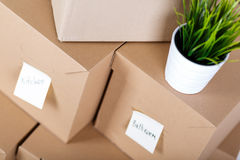 Pile of brown cardboard boxes with house or office goods Stock Image