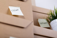 Pile of brown cardboard boxes with house or office goods Stock Photography