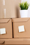 Pile of brown cardboard boxes with house or office goods Stock Images