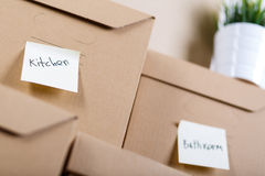 Pile of brown cardboard boxes with house or office goods Royalty Free Stock Images
