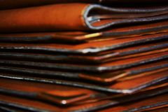 Pile brown leather menu background on the table, close up Stock Photography