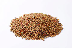 Pile of brown lentils Royalty Free Stock Images