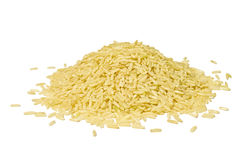 Pile of brown long rice isolated over white Royalty Free Stock Image