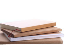 Pile of brown notebook isolated Stock Images