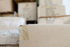 Pile of brown old used cardboard boxes at warehouse of market Royalty Free Stock Photography