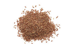 Pile of brown rice. Isolated on white background. Top view Royalty Free Stock Image