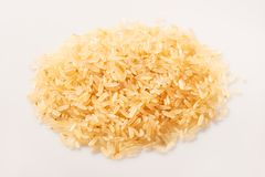 Pile of brown rice seeds on the white background Royalty Free Stock Photos