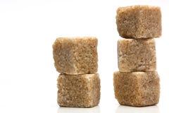 Pile of brown sugar cubes. Pile of five  brown sugar cubes Royalty Free Stock Image