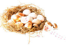 A pile of brown and white and gold eggs Royalty Free Stock Photos
