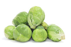 Brussels sprouts. A pile of Brussels sprouts on a white background Royalty Free Stock Image