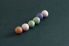 Pile of bubble gum balls on dark green background Royalty Free Stock Photography