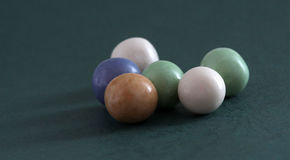 Pile of bubble gum balls on dark green background Stock Images
