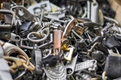 Pile of buckles, clasps, fastenings, fittings and seams for leathercraft. Pile of metal buckles, clasps, fastenings, fittings and seams for leathercraft stock photography