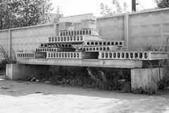 A pile of building blocks near a concrete fence. Monochrome a pile of building blocks near a concrete fence stock photos