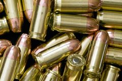 Pile of bullets -Ammunition. Piles of 308 calliber hollowpoint bullets Royalty Free Stock Photo