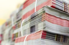 Pile of bundled magazines in offset print plant delivery department. Selective focus background royalty free stock photo