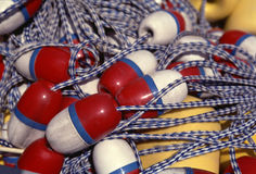 Pile on the buoy. Pile of old yellow red white and blue buoys Royalty Free Stock Photo