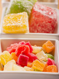 A pile of candies on a white Stock Images