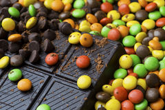 Pile of candy and chocolate bar. Close up of a pile of sweet colorful candy and chocolate bar on the table Stock Photography