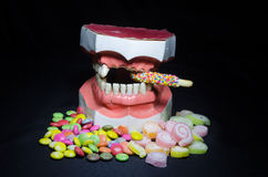 Pile of candy whit broken tooth Royalty Free Stock Photography