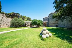 Pile of cannonballs next to Grand master palace in old town of R stock photos