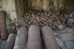 Pile of canon balls. Canon balls and canons in an abandoned castle Royalty Free Stock Photography