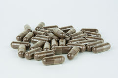 Pile of capsules. Pile of brown herbal capsules stock image