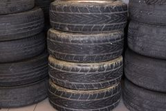 Pile of car wheel in garage. vehicle tire in auto repair service. Old tyre in automobile shop royalty free stock photography