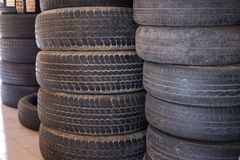 Pile of car wheel in garage. vehicle tire in auto repair service. Old tyre in automobile shop stock photos