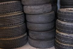 Pile of car wheel in garage. vehicle tire in auto repair service. Old tyre in automobile shop stock images