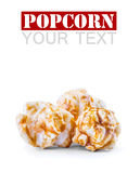 A pile of caramel popcorn on a white background. Royalty Free Stock Photos
