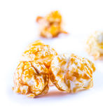 A pile of caramel popcorn on a white background. Royalty Free Stock Photo