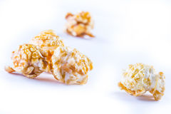 A pile of caramel popcorn on a white background. Royalty Free Stock Image
