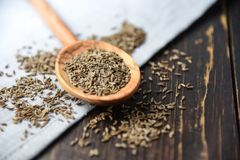 Pile of caraway on wooden table. Spice Stock Photos