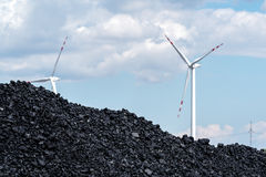 Pile of carbon and the windmill Royalty Free Stock Images