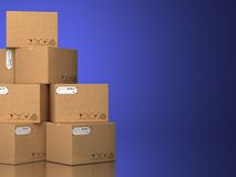 Pile of cardboard boxes on a blue background. Stock Photo
