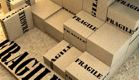 Pile of cardboard boxes with fragile sig Royalty Free Stock Photos