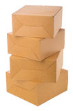 Pile of cardboard boxes over white background. Closed cardboard boxes isolated over white background Royalty Free Stock Photo