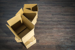 Pile of cardboard boxes on parquet  home relocation Stock Photography