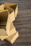 Pile of cardboard boxes on parquet  home relocation Stock Images