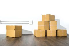 Pile of cardboard boxes on white background with box shadow Royalty Free Stock Image
